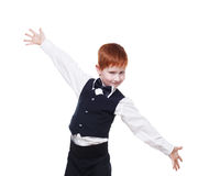 Redhead boy in a vest with bow tie, portrait isolated Stock Photography