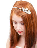 Redhead bride. Studio portrait of a young redhead bride with nice tiara in her hair Royalty Free Stock Image