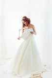 Redhead bride is holding a dress Stock Photo