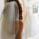 Redhead bride with thel veil in the room Stock Photo