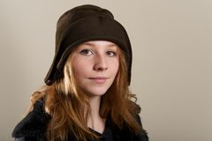 Redhead in brown cloche hat and jacket Stock Photo