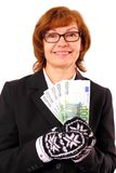 Redhead business woman holding money in Christmas winter gloves Royalty Free Stock Images
