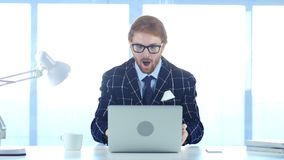 Redhead Businessman Amazed,  Surprised Man Working on Laptop. 4k , high quality Royalty Free Stock Photo