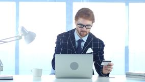 Redhead Businessman Busy in Online Shopping, Payment by Credit Card. 4k , high quality Royalty Free Stock Photos