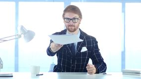 Redhead Businessman Giving Documents, Paperwork in Office stock photos