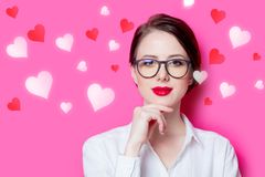 Redhead businesswoman with abstract hearts Stock Images