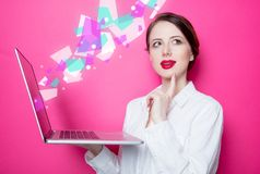Redhead businesswoman with laptop Stock Image