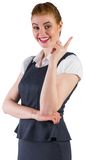 Redhead businesswoman pointing and smiling Stock Image