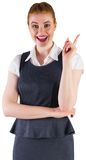 Redhead businesswoman pointing and smiling Royalty Free Stock Photography