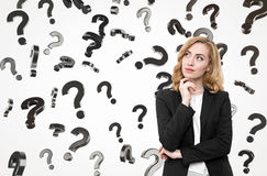 Redhead businesswoman and question marks Royalty Free Stock Photo