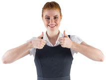 Redhead businesswoman showing thumbs up Royalty Free Stock Image