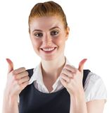 Redhead businesswoman showing thumbs up Stock Photography