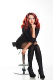 Redhead businesswoman sitting on a chair Royalty Free Stock Photography