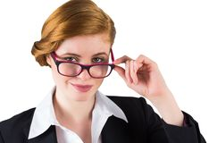 Redhead businesswoman touching her glasses Stock Photography