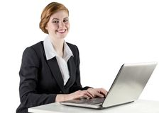Redhead businesswoman using her laptop Royalty Free Stock Photography