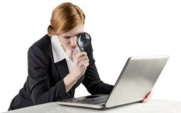 Redhead businesswoman using her laptop Stock Photography