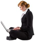 Redhead businesswoman using her laptop Stock Image