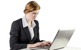 Redhead businesswoman using her laptop Royalty Free Stock Images