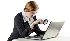 Redhead businesswoman using her laptop Stock Images