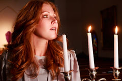 Redhead with Candelabra royalty free stock image