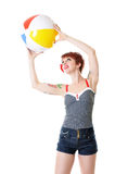 Redhead catching beach ball stock images
