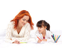 A redhead Caucasian mother and a little daughter drawing Stock Photo