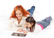 A redhead Caucasian mother and a little daughter playing together Stock Photos