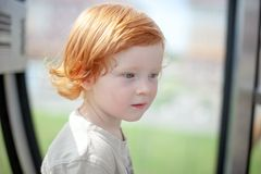 Free Redhead Child Thinks And Looks Into The Void Stock Photo - 130367320