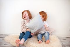 Redhead children throw pillows. In the room royalty free stock image