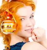 Redhead with christmas ball Royalty Free Stock Photo
