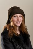 Redhead in cloche hat and leather jacket Stock Photography