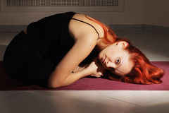 Redhead coiled up Stock Images