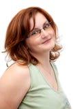 Redhead con los vidrios Fotografía de archivo libre de regalías