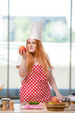 The redhead cook working in the kitchen Royalty Free Stock Image