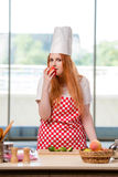 The redhead cook working in the kitchen Stock Photos
