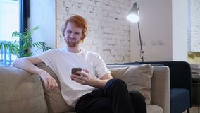 Redhead Creative Designer Upset for Loss while Using Smartphone. 4k , high quality stock video