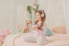 Redhead curly girl playing Royalty Free Stock Image