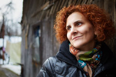 Redhead curly hair woman outdoor Royalty Free Stock Photography