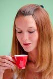 Redhead drinking coffee Stock Photography