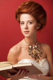 Redhead edwardian women stock images