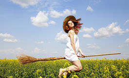 Redhead enchantress fly over spring rapeseed field Royalty Free Stock Photos