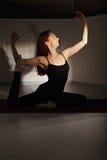 Redhead exercising hatha yoga Stock Image