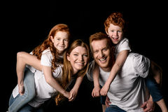 Redhead family in white t-shirts smiling isolated on black Royalty Free Stock Images