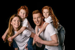 Redhead family in white t-shirts smiling isolated on black Royalty Free Stock Photography