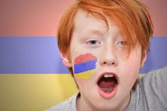 Redhead fan boy with armenian flag painted on his face Stock Image