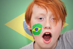 Redhead fan boy with brazilian flag painted on his face Royalty Free Stock Image