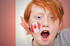 Redhead fan boy with canadian flag painted on his face