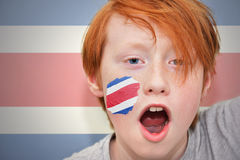 Redhead fan boy with costa rican flag painted on his face Royalty Free Stock Image