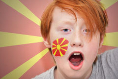 Redhead fan boy with macedonian flag painted on his face Royalty Free Stock Image