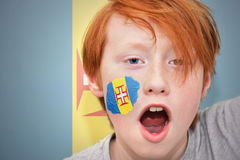 Redhead fan boy with madeira flag painted on his face Stock Photos